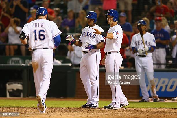 Ryan Rua Adrian Beltre and Jake Smolinski of the Texas Rangers celebrate a homerun in the 7th inning against the Houston Astros at Globe Life Park in...