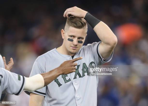 Ryan Rua of the Texas Rangers after being stranded at the end of the fourth inning during MLB game action against the Toronto Blue Jays at Rogers...