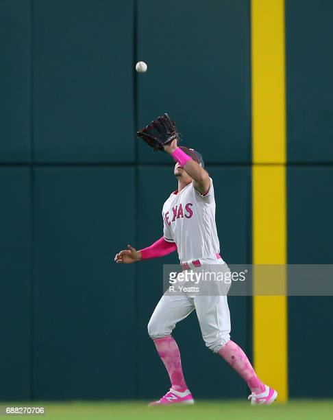 Ryan Rua of the Texas Rangers fields a fly ball in the eighth inning against the Oakland Athletics at Globe Life Park in Arlington on May 13 2017 in...