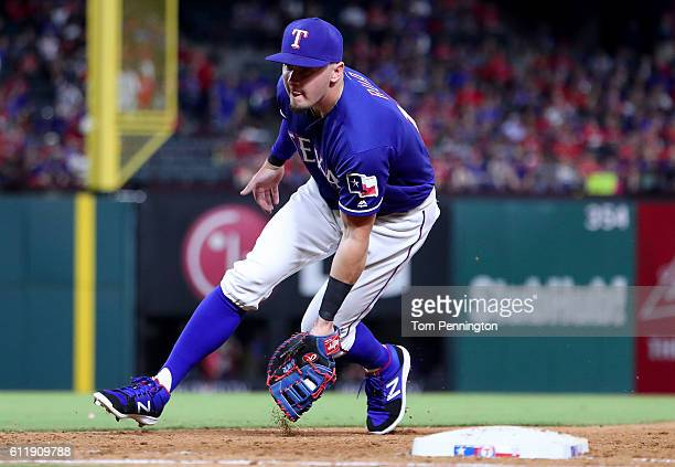 Ryan Rua of the Texas Rangers fields a ground ball against the Tampa Bay Rays in the top of the fifth inning at Globe Life Park in Arlington on...