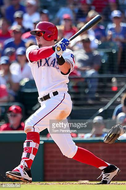 Ryan Rua of the Texas Rangers hits a single against the Tampa Bay Rays in the bottom of the fourth inning at Globe Life Park in Arlington on October...