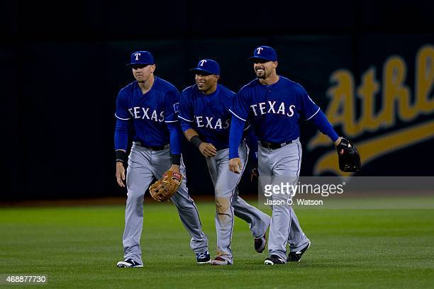 Ryan Rua of the Texas Rangers Leonys Martin and Jake Smolinski celebrate after the game against the Oakland Athletics at Oco Coliseum on April 7 2015...