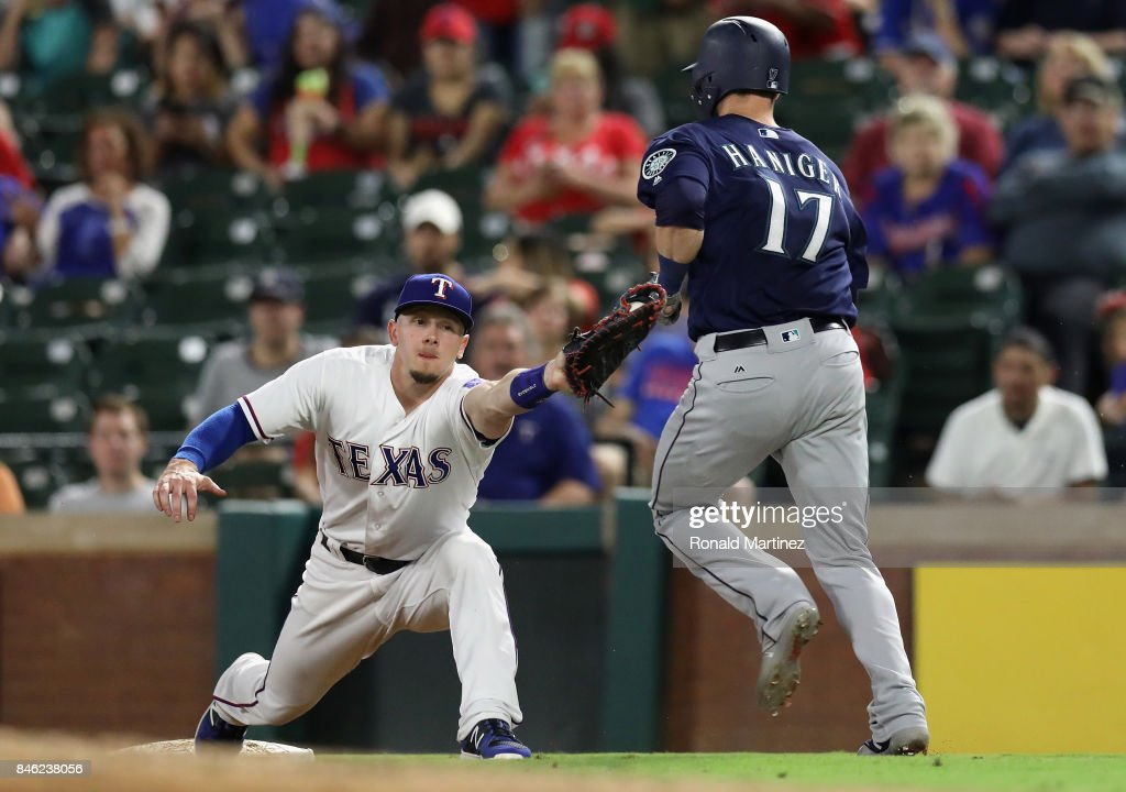 Ryan Rua #16 of the Texas Rangers makes the out at first against Mitch Haniger #17 of the Seattle Mariners in the fourth inning at Globe Life Park in Arlington on September 12, 2017 in Arlington, Texas.