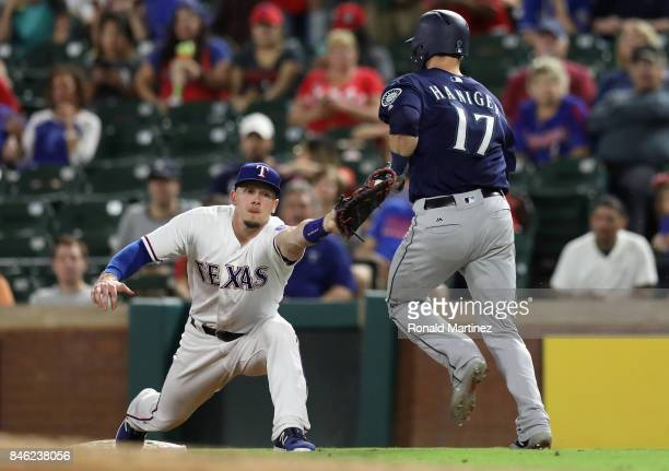 Ryan Rua of the Texas Rangers makes the out at first against Mitch Haniger of the Seattle Mariners in the fourth inning at Globe Life Park in...