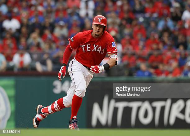 Ryan Rua of the Texas Rangers rounds first base after singling against the Toronto Blue Jays in game two of the American League Divison Series at...