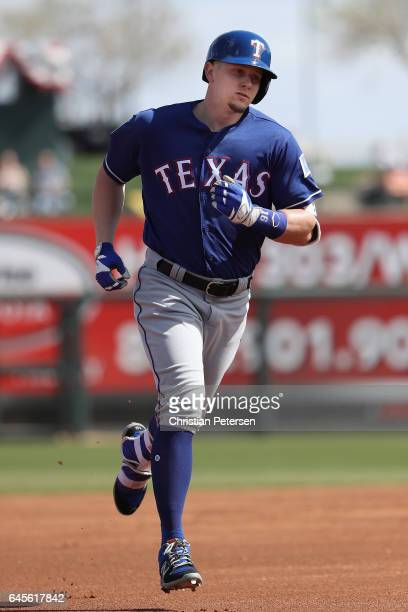 Ryan Rua of the Texas Rangers rounds the bases after hitting a tworun home run against the Kansas City Royals during the first inning of spring...