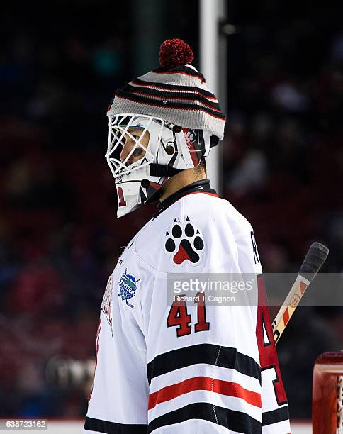 """Ryan Ruck of the Northeastern Huskies tends goal against the New Hampshire Wildcats during NCAA hockey at Fenway Park during """"Frozen Fenway"""" on..."""