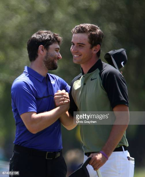 Ryan Ruffels of Australia and Kyle Stanley react after making their putt on the ninth hole during the first round of the Zurich Classic at TPC...