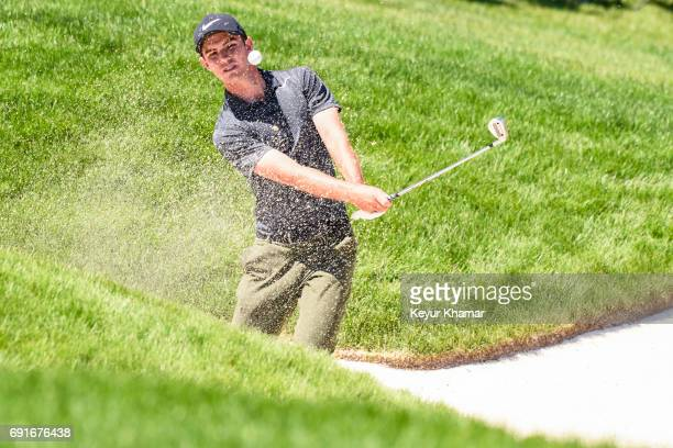 Ryan Ruffels of Australia chips out of a greenside bunker on the 18th hole during the second round of the Memorial Tournament presented by Nationwide...