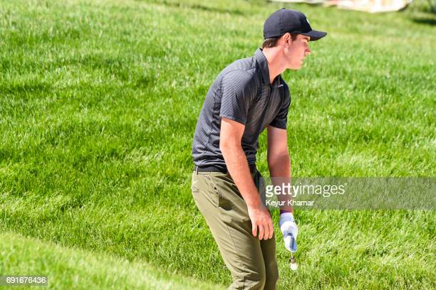 Ryan Ruffels of Australia reacts to his shot out of a greenside bunker on the 18th hole during the second round of the Memorial Tournament presented...