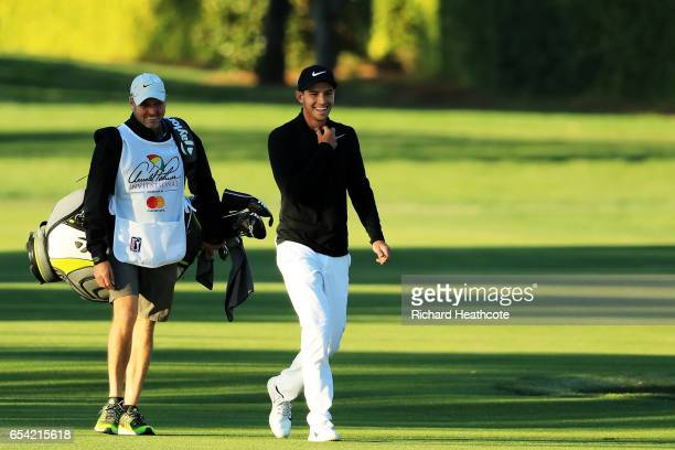 Ryan Ruffels of Australia walks with his caddie on the ninth hole during the first round of the Arnold Palmer Invitational Presented By MasterCard on...