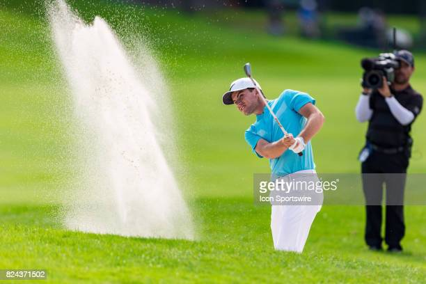 Ryan Ruffels plays a shot out of a sand trap on the 18th hole during third round action of the RBC Canadian Open on July 29 at Glen Abbey Golf Club...