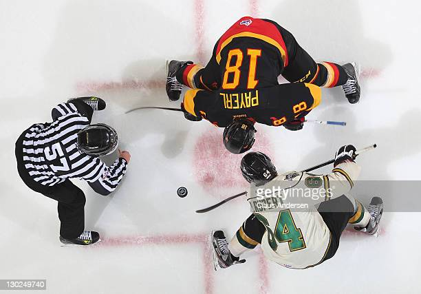 Ryan Rupert of the London Knights takes a faceoff against Adam Payerl of the Belleville Bulls in a game on October 21 2011 at the John Labatt Centre...