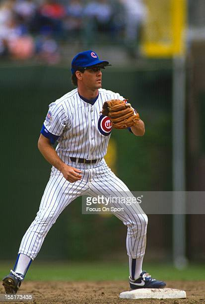 Ryan Sandberg of the Chicago Cubs looks to take a throw down at second base during an Major League Baseball game circa 1992 at Wrigley Field in...