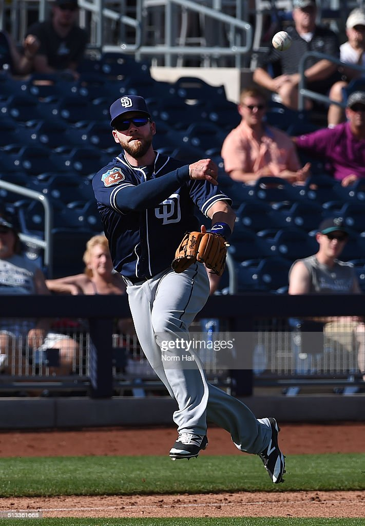 Ryan Schimpf #83 of the San Diego Padres makes a running throw to first base during the sixth inning against the Seattle Mariners at Peoria Stadium on March 2, 2016 in Peoria, Arizona. Mariners won 7-0.