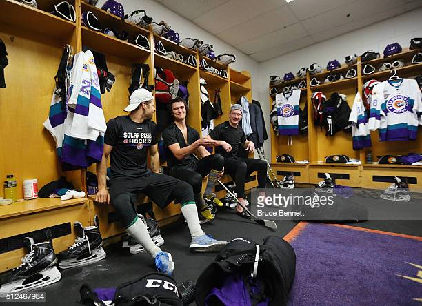 Ryan Schwartz TJ Foster and Jack Rodewald of Orlando Solar Bears prepare for their game against the Florida Everblades at the Germain Arena on...