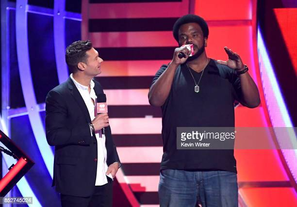Ryan Seacrest and Craig Robinson speak onstage during the 2017 iHeartRadio Music Festival at TMobile Arena on September 23 2017 in Las Vegas Nevada