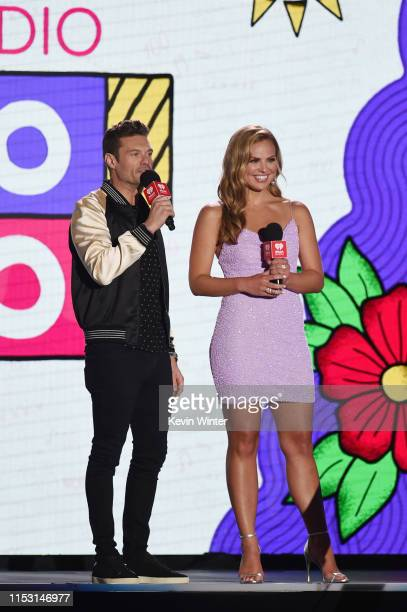 Ryan Seacrest and Hannah Brown speak onstage at 2019 iHeartRadio Wango Tango presented by The JUVÉDERM® Collection of Dermal Fillers at Dignity...