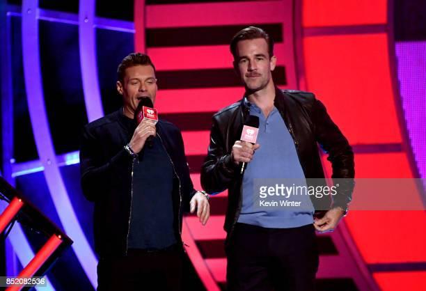 Ryan Seacrest and James Van Der Beek speak onstage during the 2017 iHeartRadio Music Festival at TMobile Arena on September 22 2017 in Las Vegas...