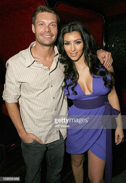 Ryan Seacrest and Kim Kardashian pose for a photo at the Keeping Up With the Kardashians viewing party at Chapter 8 Restaurant on October 16 2007 in...