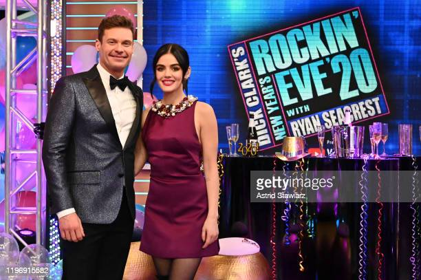 Ryan Seacrest and Lucy Hale perform during Dick Clark's New Year's Rockin' Eve With Ryan Seacrest 2020 on December 31, 2019 in New York City.