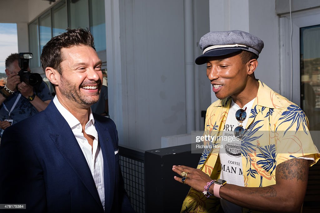 iHeartMedia Hosts Main Stage Fireside Chat About Creativity With Radio And Television Host And Producer Ryan Seacrest And Grammy Award winner Musician/Entrepreneur Pharrell Williams : News Photo