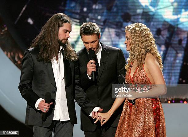 Ryan Seacrest and the two American Idol finalists Bo Bice and Carrie Underwood await the final decision onstage the American Idol Finale Results Show...