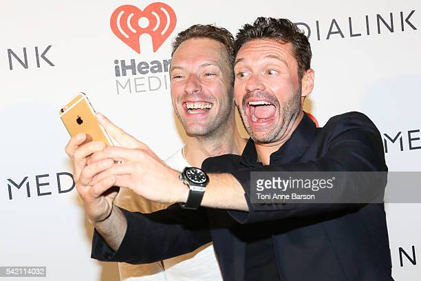 Ryan Seacrest doing a selfy with Chris Martin at a dinner party hosted by iHeartmedia and Medialink featuring a special performance by Chris Martin...