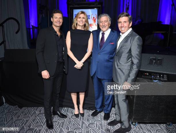 Ryan Seacrest joins Tony Bennett Susan Benedetto and the evening's honoree Rich Bressler at the 11th Annual Exploring the Arts Gala hosted by Tony...