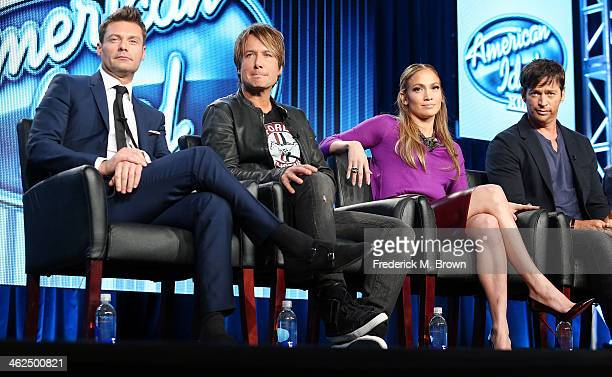 Ryan Seacrest Keith Urban Jennifer Lopez and Harry Connick Jr of the television show 'American Idol' speak during the FOX portion of the 2014...