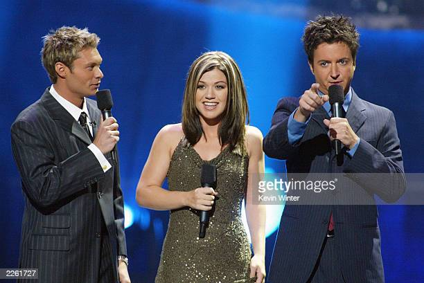 Ryan Seacrest Kelly Clarkson and Brian Dunkleman at FOXTV's 'American Idol' finals at the Kodak Theatre in Hollywood Ca Tuesday Sept 3 2002 Photo by...