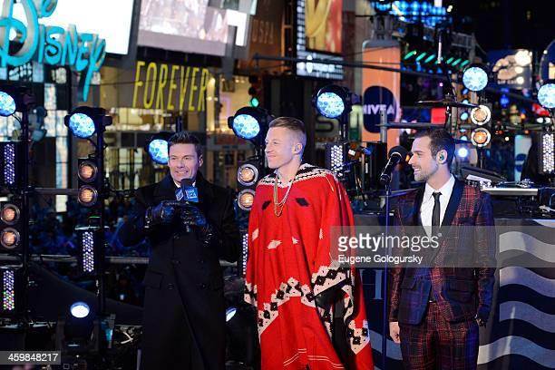Ryan Seacrest Macklemore and Ryan Lewis at New Year's Eve Countdown at Times Square on December 31 2013 in New York City