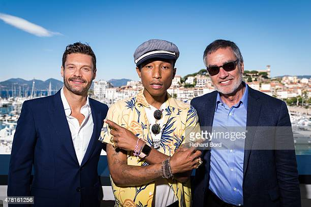 Ryan Seacrest Pharrell Williams and Bob Pittman pose on the balcony of the palais after the seminar as iHeartMedia hosts the main stage fireside chat...