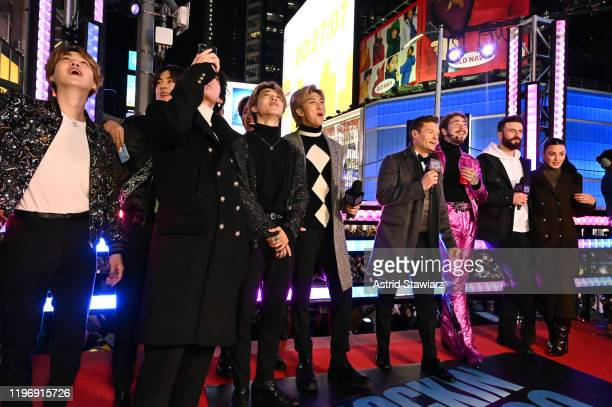 BTS Ryan Seacrest Post Malone and Sam Hunt attend Dick Clark's New Year's Rockin' Eve With Ryan Seacrest 2020 on December 31 2019 in New York City