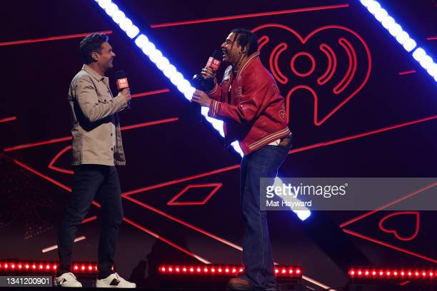 Ryan Seacrest presents 24kGoldn with the iHeartRadio Titanium Award onstage during the 2021 iHeartRadio Music Festival at T-Mobile Arena on September...