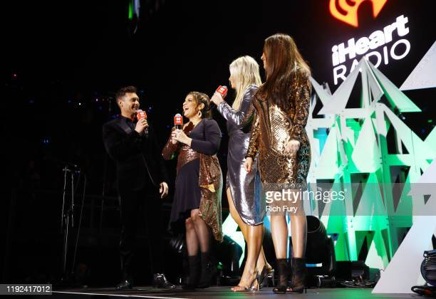 Ryan Seacrest Sisanie Tanya Rad and Patty Rodriguez speak onstage during 1027 KIIS FM's Jingle Ball 2019 Presented by Capital One at the Forum on...
