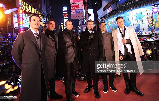 Ryan Seacrest speaks with Jordan Knight Jonathan Knight Donnie Wahlberg Danny Wood and Joey McIntyre of New Kids On The Block at Dick Clark's New...