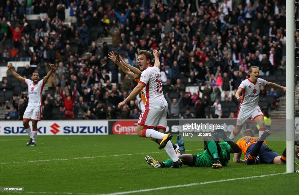 Ryan Seager of Milton Keynes Dons celebrates Ed Upson's goal during the Sky Bet League One match between Milton Keynes Dons and Oldham Athletic at StadiumMK on October 21, 2017 in Milton Keynes, England.