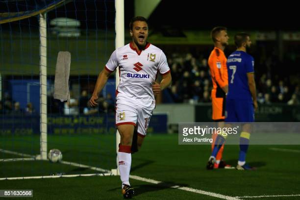 Ryan Seager of MK Dons celebrates after scoring his sides first goal during the Sky Bet League One match between AFC Wimbledon and Milton Keynes Dons...
