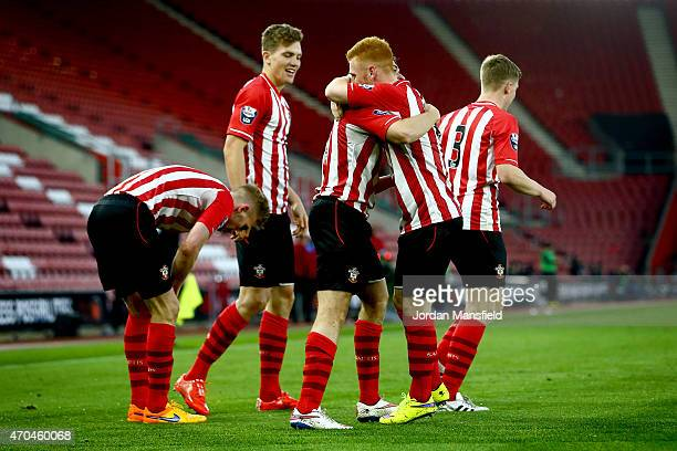 Ryan Seager of Southampton is congratulated by his teammates after scoring to make it 10 during the Under 21 Premier League Cup Final Second Leg...