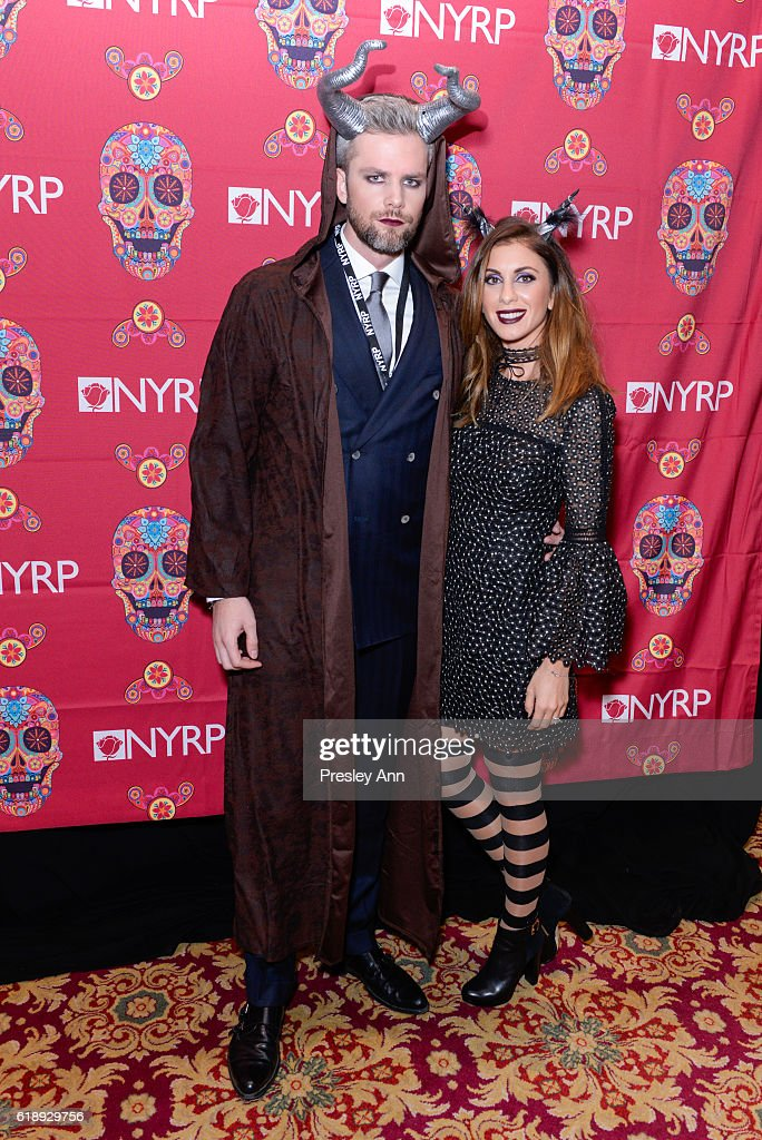 Ryan Serhant and Emilila Serhant attend Bette Midler's Annual Hulaween Bash celebrating the New York Restoration Project at the Waldorf=Astoria on October 28, 2016 in New York City.