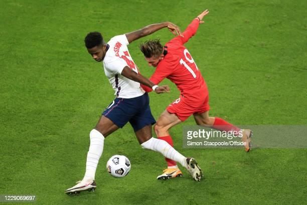 Ryan Sessegnon of England battles with Serkan Asan of Turkey during the UEFA Euro Under 21 Qualifier match between England U21 and Turkey U21 at...