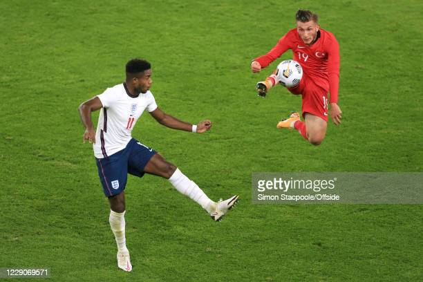 Ryan Sessegnon of England looks on as Serkan Asan of Turkey leaps to control the ball during the UEFA Euro Under 21 Qualifier match between England...