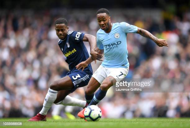 Ryan Sessegnon of Fulham and Raheem Sterling of Manchester City battle for the ball during the Premier League match between Manchester City and...