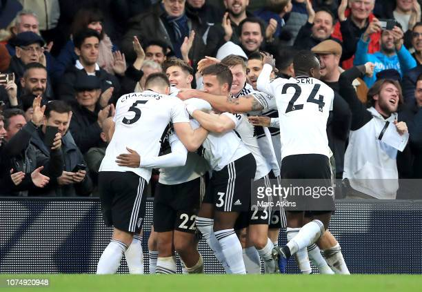 Ryan Sessegnon of Fulham celebrates after scoring his team's first goal with his team mates during the Premier League match between Fulham FC and...