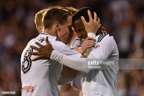 Ryan Sessegnon of Fulham celebrates with team mate Stefan Johansen after scoring his sides first goal during the Sky Bet Championship Play Off Semi...