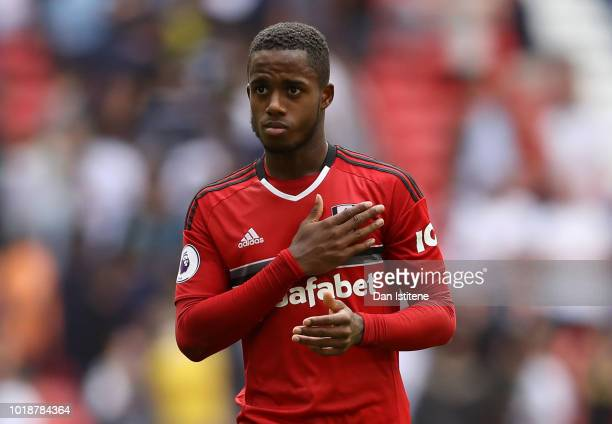 Ryan Sessegnon of Fulham holds his team badge following the Premier League match between Tottenham Hotspur and Fulham FC at Wembley Stadium on August...