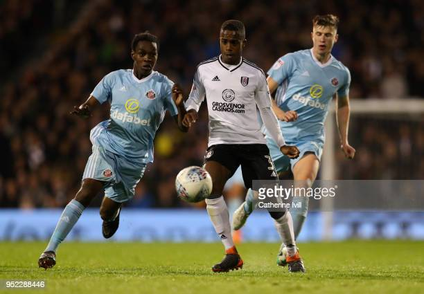 Ryan Sessegnon of Fulham in action with Joel Asoro of Sunderland during the Sky Bet Championship match between Fulham and Sunderland at Craven...