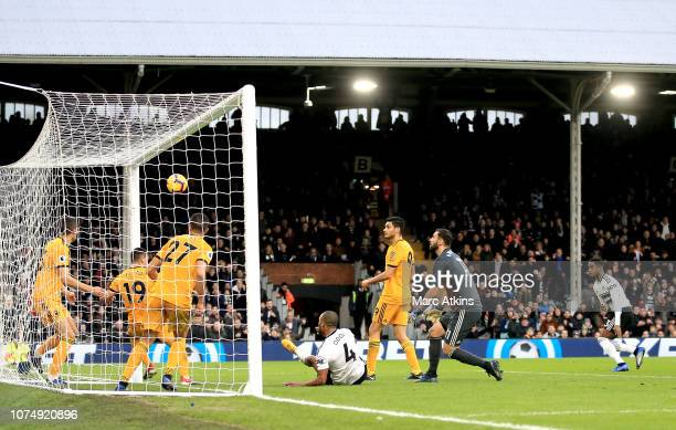 Ryan Sessegnon of Fulham scores his team's first goal during the Premier League match between Fulham FC and Wolverhampton Wanderers at Craven Cottage...