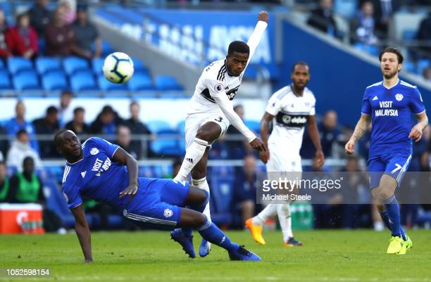 Ryan Sessegnon of Fulham shoots as Sol Bamba of Cardiff City blocks during the Premier League match between Cardiff City and Fulham FC at Cardiff...